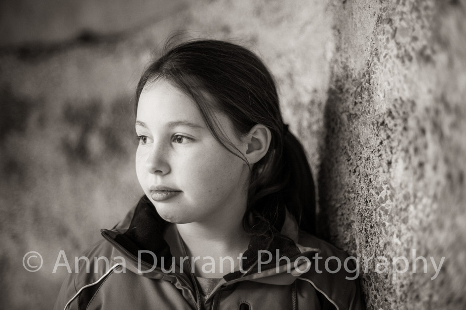 girl looking pensively out of the picture