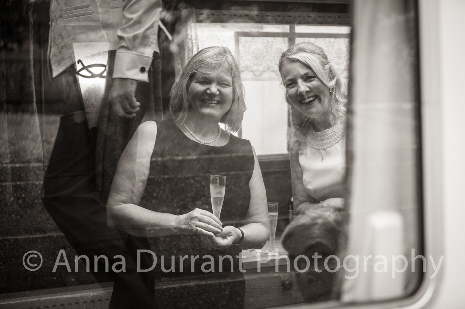 Bride and guest through Dutch barge window