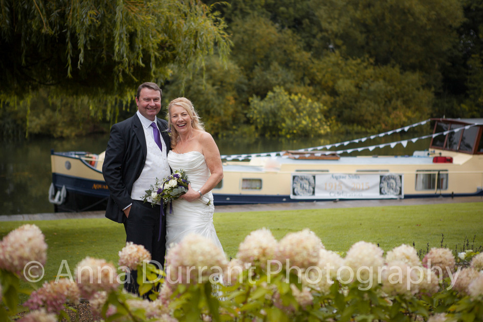 Bride and groom standing in front of Dutch barge