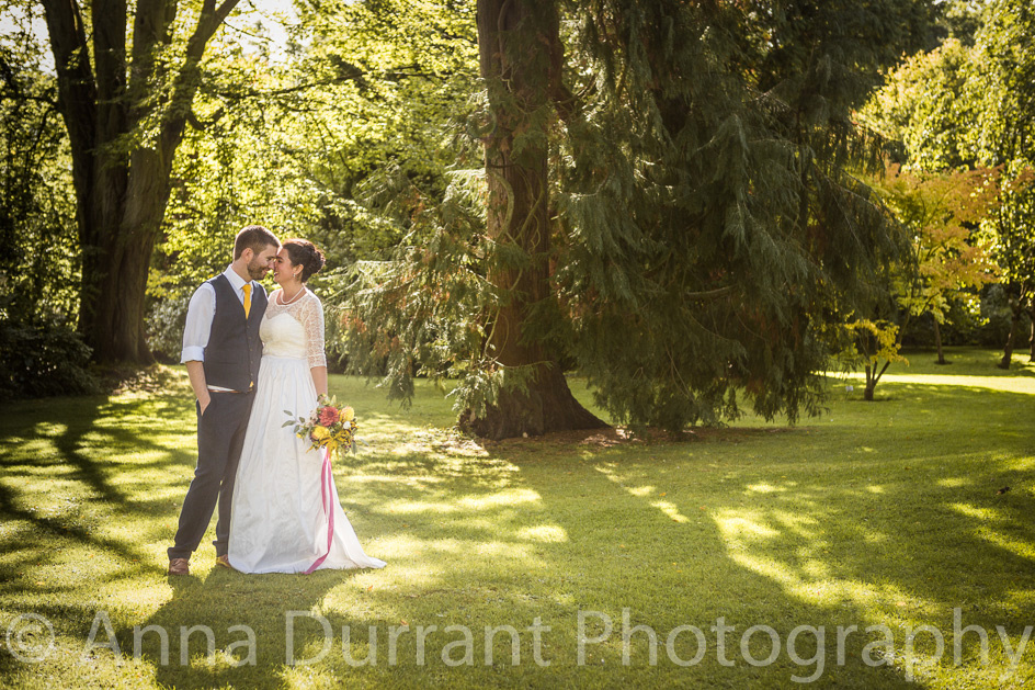 Bride and groom in parkland