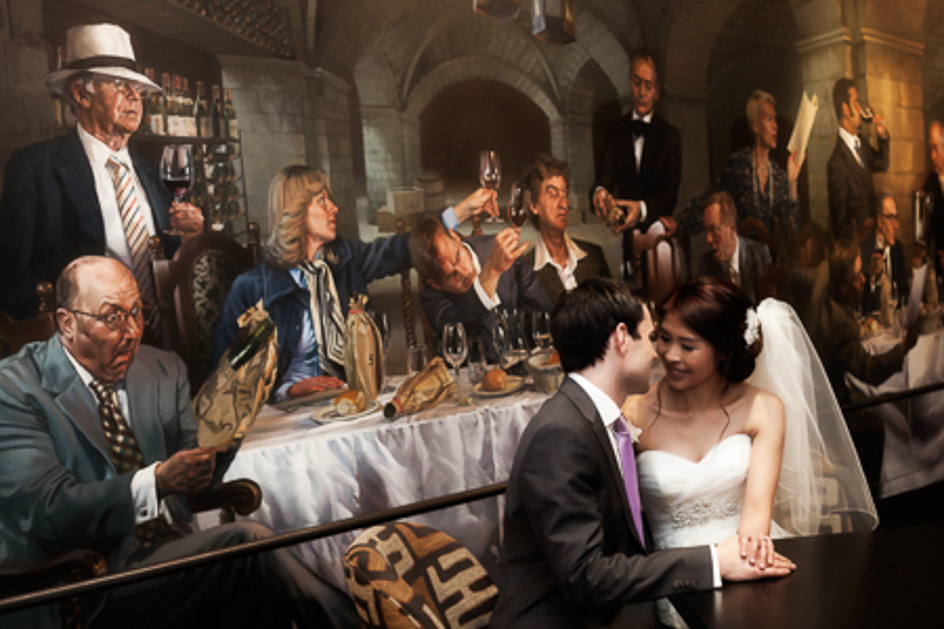 A wedding couple sitting in front of a mural