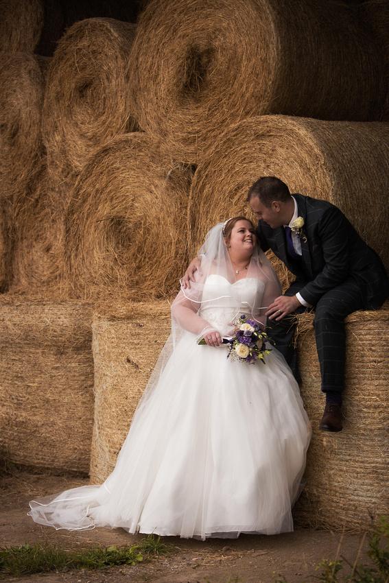 Bridal couple in hay barn