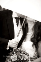 Wedding kiss obsured by umbrella