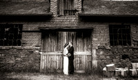 Bride and groom posing by a disused slate mine