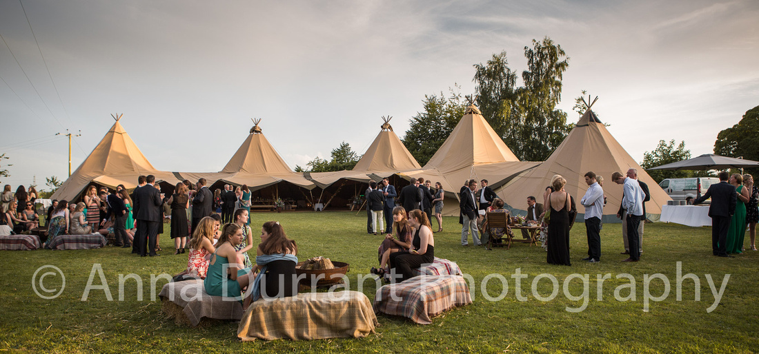 Tipi tents in field at Wiltshire birthday party