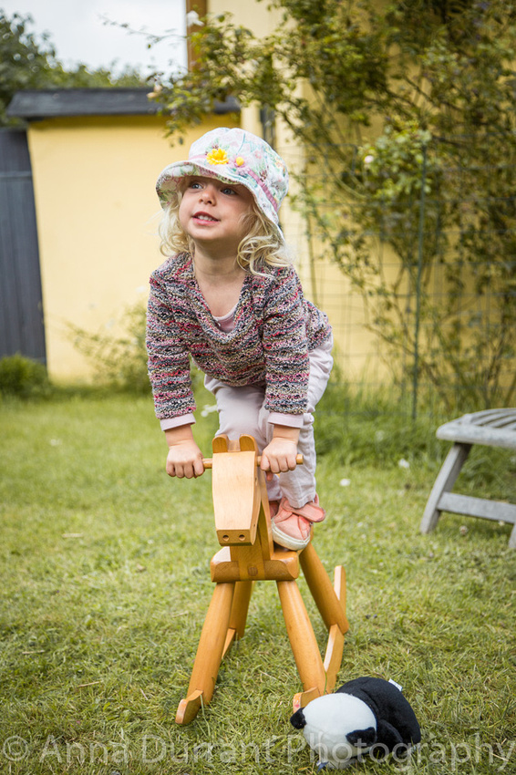 Toddler balancing on rocking horse